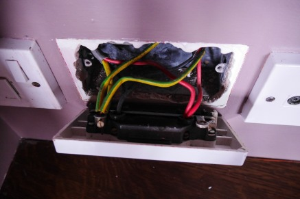 Unscrew the old socket and note the wiring configuration